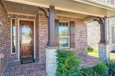 This charming Texas Hill Country front porch features cedar style beams,  columns and shutters and Alamo Stone to enhance the A   curb appeal.  The eight foot knotty alder door with lone star leaded glass welcomes guests.
