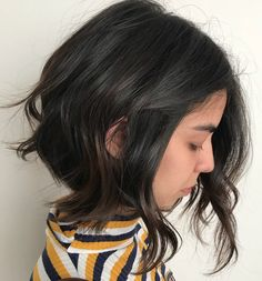 Messy Black Bob with Subtle Highlights