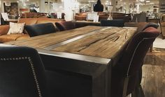 The Halo Foundry Table has been constructed from old Chinese doors with a polished iron frame which also runs down the middle of the table. The table is surrounded by Halo Mimi Dining Chairs in an assortment of colours