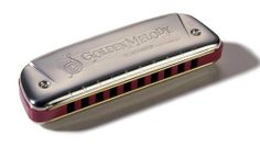 Golden Melody Harmonica in Chrome - Key of F# by Hohner. $37.99. 542F# Features: -Harmonica.-Material: Plastic comb, brass reed plates.-10 Holes, 20 reeds.-Key of F#.-Equal tempered tuning, especially suitable for melody playing. Color/Finish: -Color: Chrome. Dimensions: -Dimensions: 1'' H x 4.13'' W x 1'' D.