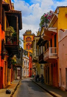 Cartagena de Indias Colombia Colorful narrow street with flowers and quaint balconies. The gorgeous coastal city of Cartagena offers cool sea breezes and a lively dining scene. Enjoy authentic local dishes at these 10 best eateries in Cartagena. Places Around The World, The Places Youll Go, Travel Around The World, Places To See, Around The Worlds, Colombia Travel, Visit Colombia, South America Travel, Old Town