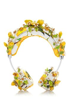 A celebration of Italy as seen through the eyes of tourists in post-World War II Italy was the theme for Stefano Gabbana and Domenico Dolce's Spring 2015 collection. A collaboration with Frends, these **Dolce & Gabbana** headphones are crafted in calf leather and feature an intricate lemon floral design.