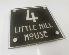 Slate House Sign? NO it's a Modern GunMetal Acrylic House Sign Slate House Sign? NO it's a Modern GunMetal Acrylic House Sign and it's NOW On Offer. 20% off The Large Square GunMetal Sign Now £28.80 + p&p in our 5mm standard material or for a more prestigious sign in 10mm thick material its Now £49.92 + p&p http://www.de-signage.com/large-square-house-sign.php