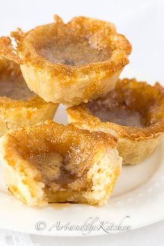 Indulge in some great Old Fashioned Butter Tarts. A Canadian classic dessert rec… Indulge in some great Old Fashioned Butter Tarts. A Canadian classic dessert recipe with sweet, slightly runny filling and flaky melt in your mouth pastry. Tart Recipes, Sweet Recipes, Baking Recipes, Cookie Recipes, Just Desserts, Delicious Desserts, Yummy Food, Best Dessert Recipes, Holiday Baking
