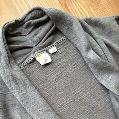 """Anthropologie Sparrow semi-sheer open gray cardi Intricate knit open shawl cardigan from the well-loved line Sparrow, sold exclusively at Anthropologie. Ramie, rayon blend, this is a very light knit layer perfect for spring. 3/4 sleeves. Open front. 33""""L in front, 26""""L in back. 21"""" sleeves. Handwash. Good preloved condition. Size Small. Anthropologie Sweaters Cardigans"""