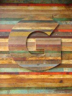 Guru signage is Gotham G in wood