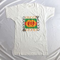 cf98413c5d6 Vintage 80s Bootleg Gucci Logo Puffy Print T-Shirt http   www.