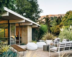 Modern Furniture Fit for a Classic Eichler In the backyard of this Eichler home in San Rafael, California, a pair of whitebeanbag chairs, outdoor sofa, and chairs were sourced from West Elm and the Case Study Museum Bench is from Modernica. Photo by:Drew Kelly  Photo by Drew Kelly.   This originally appeared in Modern Furniture Fit for a Classic Eichler.