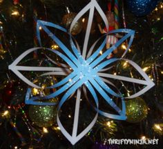 How to make gorgeous snowflakes with a few strips of paper and a glue stick  via http://thriftyninja.net/2011/12/diy-paper-snowflakes-23-days-of-handmade-christmas/