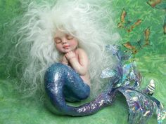 Adorable baby mermaid sculpture by JoyzanzCreations on Etsy ~ Joyce Collins.