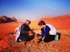 Take your child travelling- games are from nature; played in amazing places; with people of all cultures. Here Explorason and our 4-wheel driver play a game throwing and catching then stacking stones at Wadi Rum. Wadi Rum is an amazing desert area in Jord