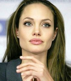 """People wonder aloud about whether I am an okay mother. That is obviously painful because it's so important to me. It's hard to hear that people think I'm not a capable mother and a good person, that they just think I'm nuts."" – Angelina Jolie"