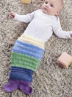 Free Knitting Pattern for Baby Mermaid Tail - This baby cocoon by Karen Wiederhold for Let's Knit uses a combination of knit and purl stitches to give the effect of scales. Great photo prop