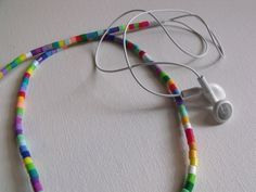 Beaded headphones made from Perler beads. Use an X-Acto knife to put a slit in each bead to slip them onto the cord. Diy Arts And Crafts, Bead Crafts, Craft Gifts, Diy Gifts, Jewelry Boards, Perler Beads, Diy Tutorial, Cord, Headphones