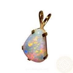 Ladies Opal pendant in a simple 14k Yellow Gold setting with a beautiful 5 carat Crystal Opal that has a great mix of very bright colors. The Coober Pedy Crystal Opal is free form in shape and prong set in a solid 14k Gold basket setting to showcase just the gem quality opal.