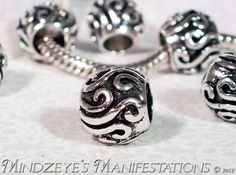 http://tophatter.com/auctions/11540    5 Silver Plated Wave Adorned Euro Beads $3