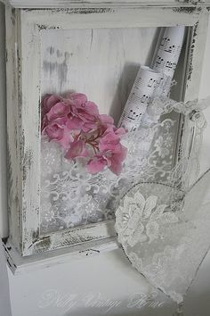 What a sweet idea for a shabby frame! Sheet music and flowers :)
