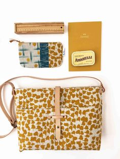 a124b49b0d7 Canvas zippered shoulder bag with with mustard print and a leather strap,  for work or