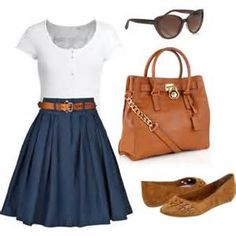 White fitted top, navy knee-length full skirt, brown leather belt & bag, matching tan flats, tan sunglasses