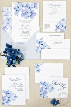This watercolor plumbago floral wedding invitation is so sweet! Fully customizable. Shown in periwinkle. Plus, it's original painted artwork! #weddinginvitation