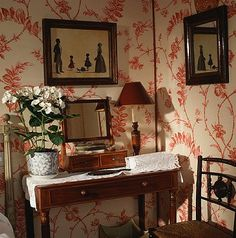 fetching red print wallpaper with silhouettes