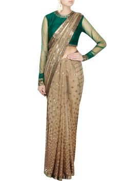 Featuring an intricately embroidered tortilla brown net saree with underskirt. It comes with with an emerald green raw silk blouse with silk lining, net sleeves and a classy back with potli buttons  . Fabric: Net,Raw silk  Care Instructions: Dry clean only.