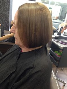 Side view of all over tint and bob haircut