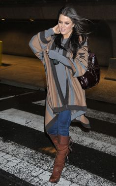 Khloe Kardashian i do like this flowing pull on with the tall boots and denim with extra long sweater sleeves