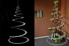 . Een illusionistische kerstboom     Tannenboing zorgde voor een aluminium kerstboom in de vorm van een spiraal. Strak in zijn geheel, feestelijk met de nodige versiering, maar vooral: rustgevend om naar te staren hoe de spiraal 'stijgf' of 'daalt'.