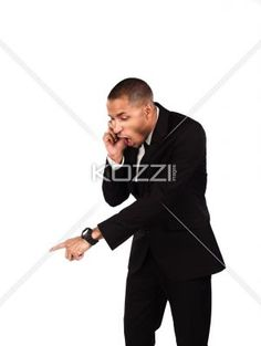 angry businessman gesturing while talking on cellphone. - Angry businessman gesturing while talking on cellphone over white background, Model: Kareem Duhaney
