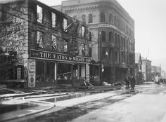 Bank Street showing furniture store and Eaton & Wilson Company. Day file photo of the aftermath of the Hurricane of 1938 in New London Conn.  View of Bank street.