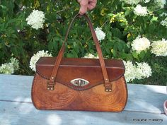 Hey, I found this really awesome Etsy listing at https://www.etsy.com/listing/107802550/vintage-hand-tooled-leather-bag