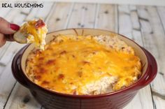 Warm & Cheesy Crack Dip      8 oz cream cheese, softened     1 (1oz) package Ranch dressing mix     1 (3oz) container prepared bacon bits     2 cups cheddar cheese, shredded     16 oz sour cream  Instructions      Preheat oven to 400 degrees.     In bowl, combine all ingredients; mix well.     Transfer to 2-quart baking dish; cover.     Bake for 25 to 30 minutes or until hot and bubbly.     Serve warm.