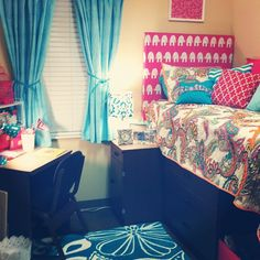 bright dorm room featuring Premier Fabrics Ele Candy Pink (headboard), Sydney Candy Pink (throw pillow), Zig Zag True Turquoise (throw pillow)