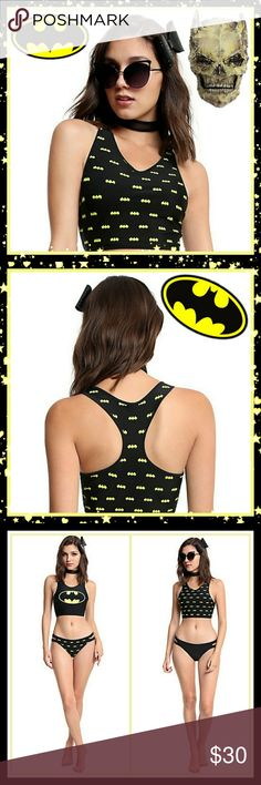 DC Comics Batman Reversible Swim Top Batman maintains a secret identity and we get that sometimes you might have to do the same. That's why we came up with this reversible swim top. One side of the athletic cut racer back swim top has an allover Batman logo print for when you're just a bat fan, the other is solid black with a large Batman logo over the chest for those moments when you're Batman. Always be yourself, unless you can be Batman. Then be Batman.  80% nylon; 20% spandex Wash cold…
