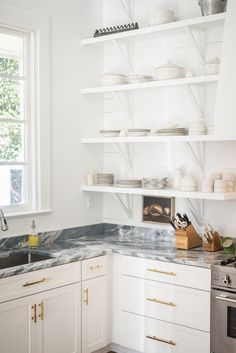 You know what goes well with an all-white kitchen? GOLD! Gold hardware to be exact. #Gold used correctly in home decor can be eye-catching in its subtleties. See for yourself at dubendorfer.biz #kitchenremodel #kitchenrenovation