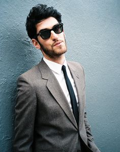i love this suit and skinny tie. and the ray bans!