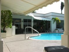Fabric patio awning by a pool