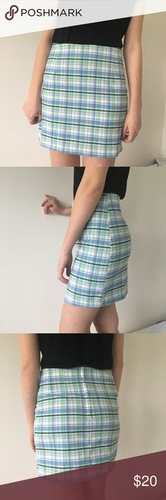 "Vintage Blue and Green Plaid Skirt amazing for spring/easter! amazingly lightweight high-waisted plaid skirt. hits about mid thigh on this model (who is 5'8), but check your measurements! so comfy and cute. zips up in the back. pair with some sandals and a white blouse and ur good to go on a picnic! vintage size 9, fits like a small-medium.  waist-28"" hip-34"" length-36"" rise-8"" Skirts Mini"
