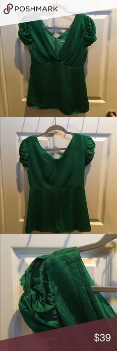 Silk Nanette Lepore top Beautiful emerald green hammered silk Nanette Lepore blouse, size 6.  Faux wrap neckline and cap sleeves with small top slit.  Back zip, fully lined. Nanette Lepore Tops