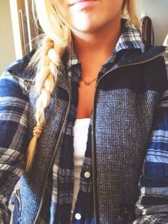 Stylish vest over plaided sweater with cute braid