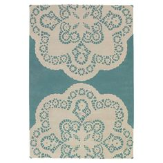 Doily-inspiration.  Hand-tufted New Zealand wool rug with a doily motif.     Material: 100% New Zealand wool.  Color: Turquoise.  Features:  Doily design.      Handmade in India.  Designed by Thomas Paul, United States