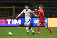 Alex Ferrari (L) of Italy is challenged by Kasper Junker of Denmark during the International Friendly match between Italy U21 and Denmark U21 at Stadio Atleti Azzurri d'Italia on November 14, 2016 in Bergamo, Italy.