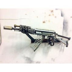 SBR AK47 made from scrap metal. This sculpture is made to order and will look very similar to pictures. Every AK47 is numbered and signed. (All scrap is unique and slight details will be different) AK47 sculpture can be made to any spec. or modeled after your own. Wall mount can be made to