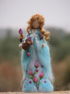 Needle felted waldorf inspired doll holding roses