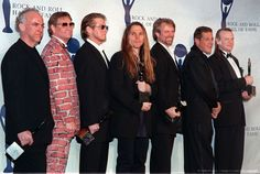 Every member of the Eagles (1998 Rock and Roll Hall of Fame Induction Ceremony) - (left to right): Bernie Leadon (guitar, mandolin, banjo), Joe Walsh (guitar, vocals), Don Henley (drums, vocals), Timothy B. Schmit (bass, vocals), Don Felder (guitar), Glenn Frey (guitar, vocals), and Randy Meisner (bass, vocals)