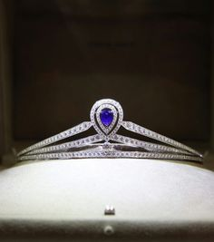 Chaumet Joséphine tiara in platinum, paved with brilliant-cut diamonds, set with a pear-cut sapphire.