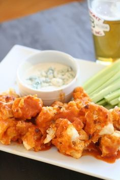 Buffalo Cauliflower. This is our new favorite recipe!! But we cook it at a lower temperature for a longer period of time so that they get crispy. Yum!