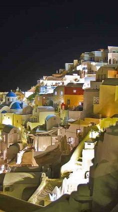 August night at the caldera of Oia village, Santorini island, Greece // by Alexandros Maragos