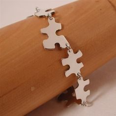 Puzzle link bracelet jigsaw  sterling silver by sarantos on etsy from etsy.com